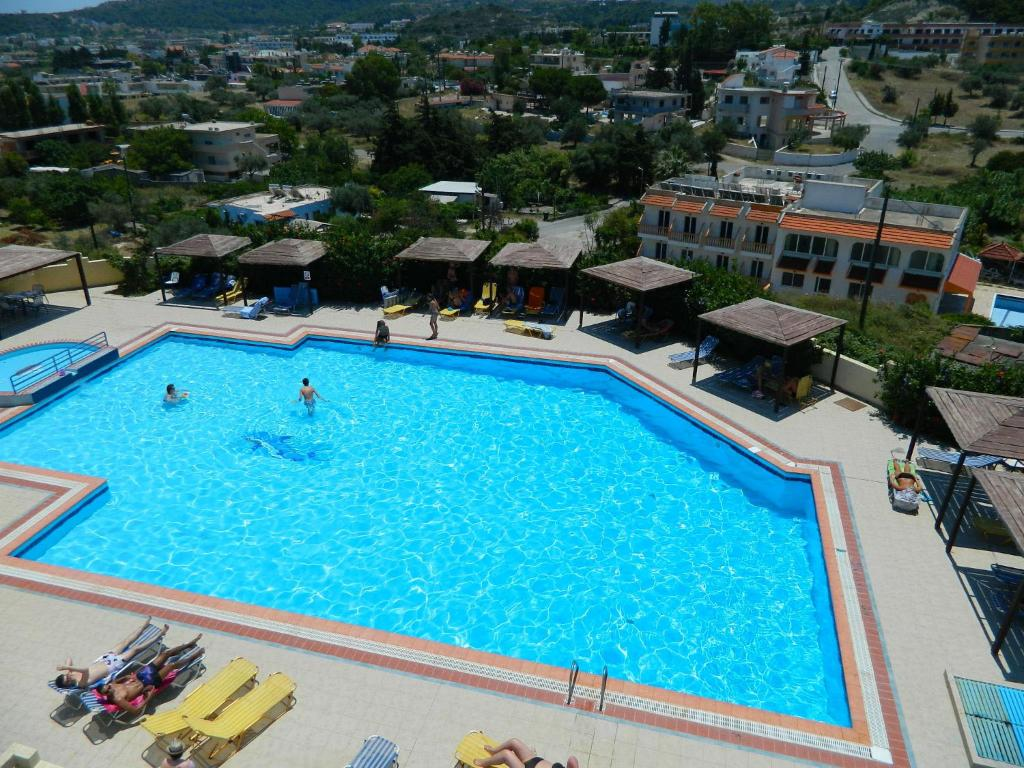 A view of the pool at Telhinis Hotel or nearby