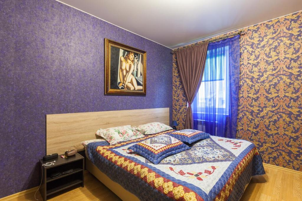 A bed or beds in a room at Hotel GH AurorA Domodedovo