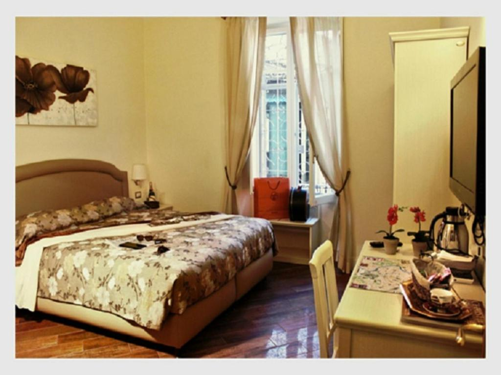 A bed or beds in a room at Locanda Colosseo