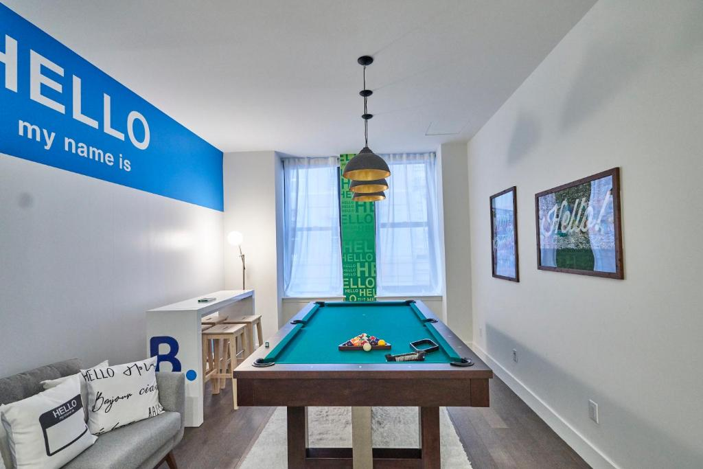 A billiards table at Resolution Suite: Meet New People