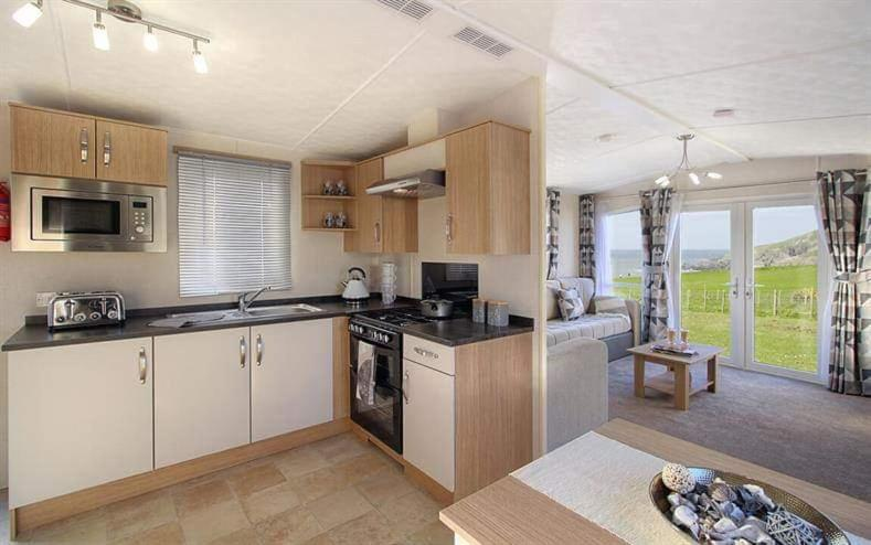 A kitchen or kitchenette at Three Lochs Holiday Park