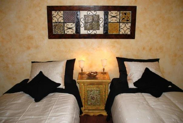 A bed or beds in a room at AirCiampino B&B