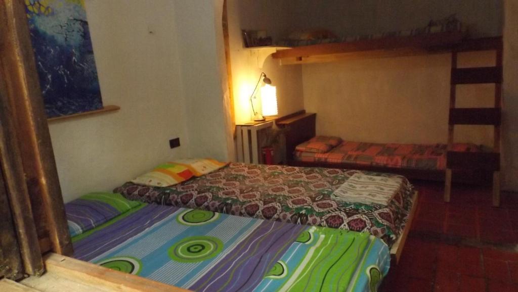 Una cama o camas en una habitación de CASA NANAMA
