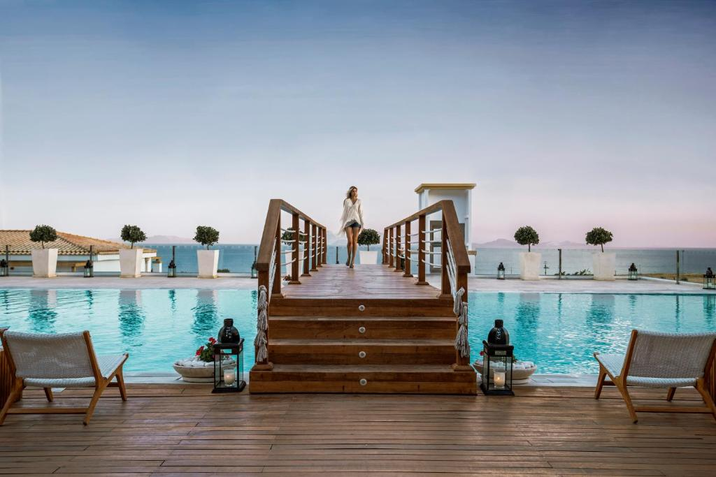 The swimming pool at or near Mitsis Blue Domes Resort & Spa