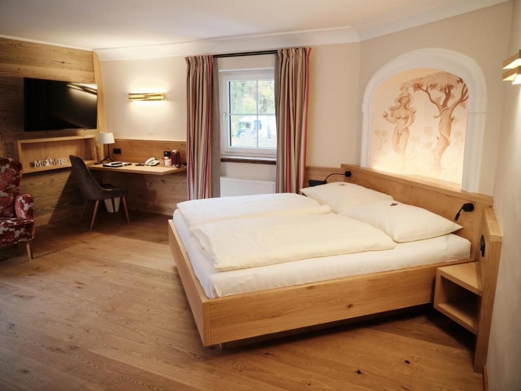 Ein Bett oder Betten in einem Zimmer der Unterkunft Gasthof Schorn