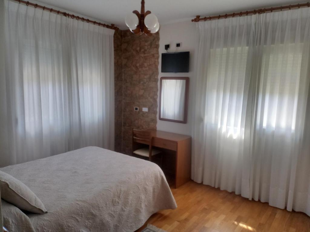 Кровать или кровати в номере Hotel Arume
