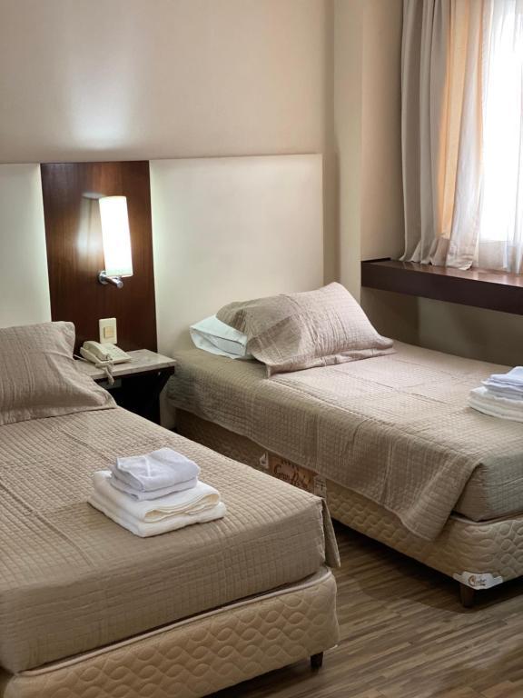 Cama ou camas em um quarto em CHARMOSO FLAT NA ALAMEDA SANTOS