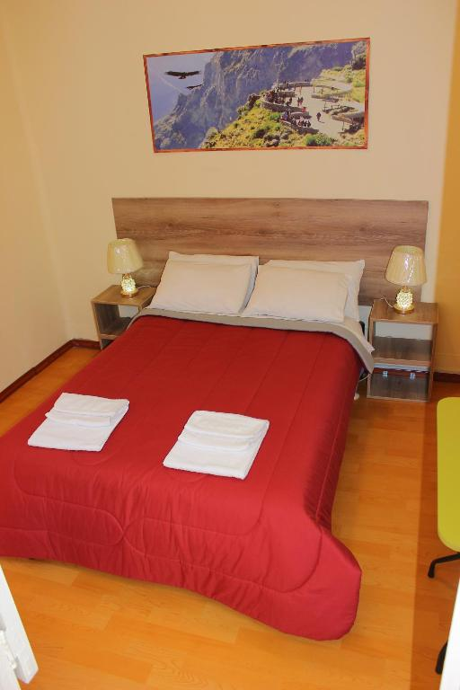 A bed or beds in a room at Holidays Hostel Arequipa