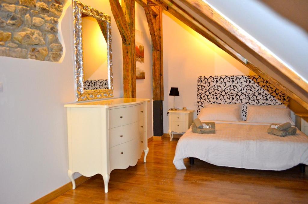 מיטה או מיטות בחדר ב-Dolce Vita Suites Boutique