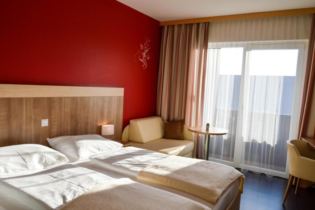 Ein Bett oder Betten in einem Zimmer der Unterkunft Das Römerhof