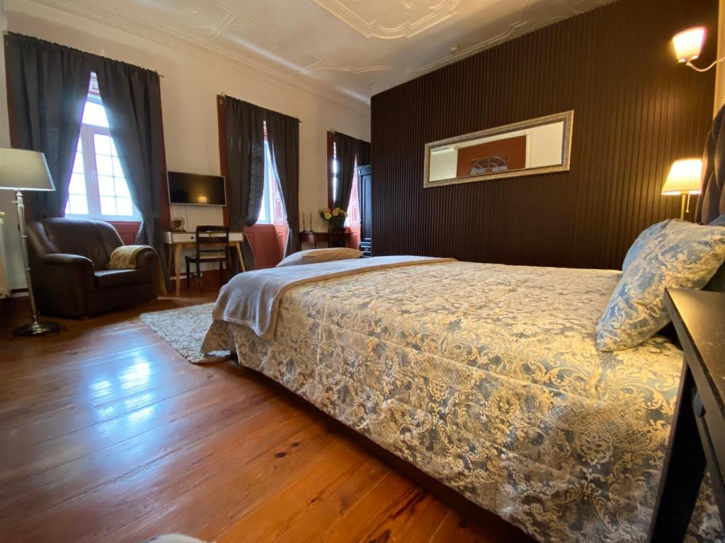 A bed or beds in a room at Casa Cimeira