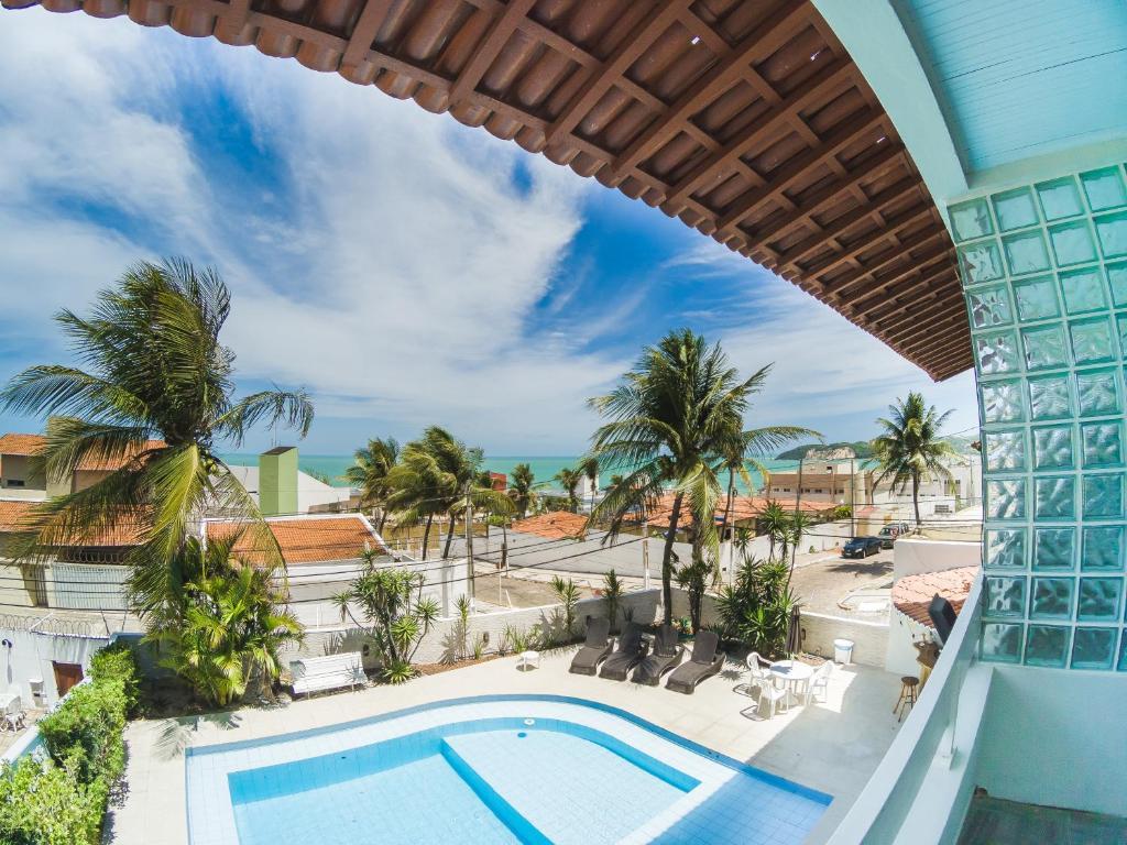 Uma vista da piscina em Casa Turquesa ou nos arredores