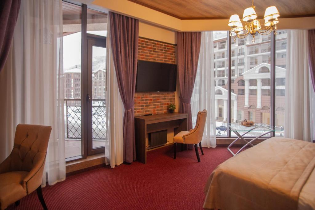 Телевизор и/или развлекательный центр в VERTEX hotel