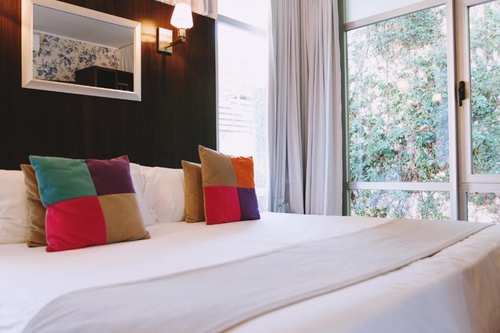 Una cama o camas en una habitación de Ribera Sur Hotel
