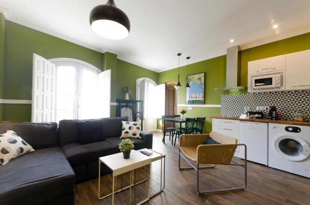 Zona de estar de Apartamentos Suites Roma