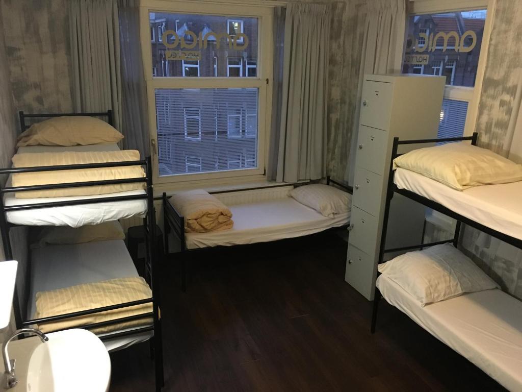 A bunk bed or bunk beds in a room at Amigo Budget Hostel