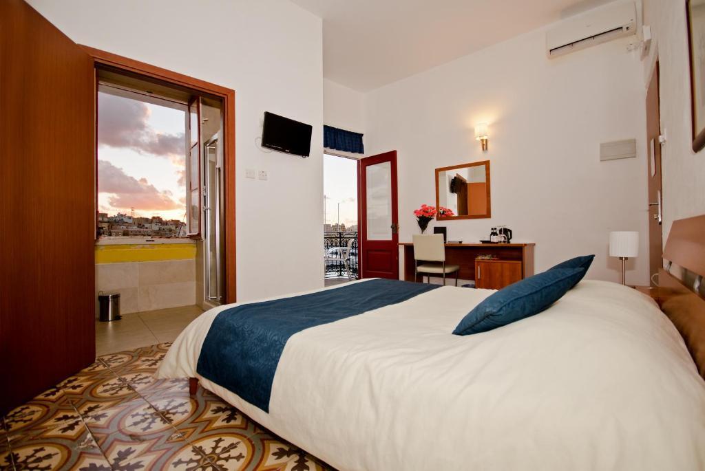 เตียงในห้องที่ Villa Del Porto