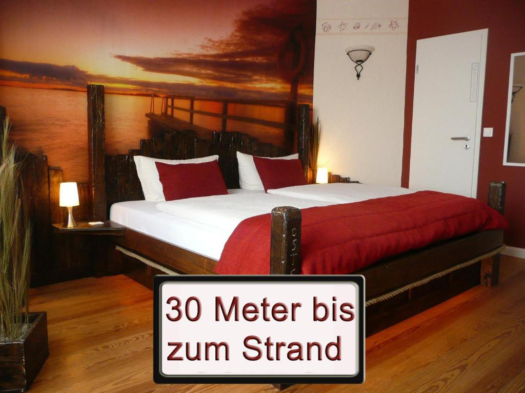 A bed or beds in a room at Haus Strandperle