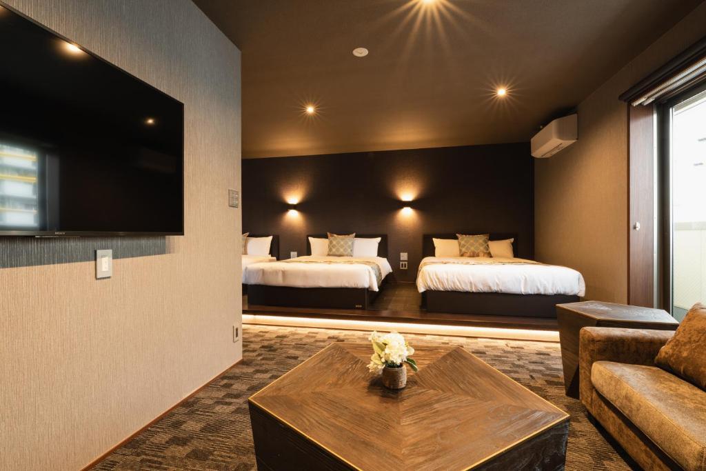 GRAND BASE Haruyoshiにあるベッド