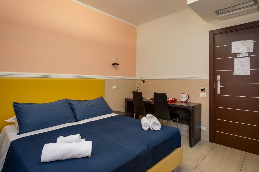 A bed or beds in a room at Mocenigo Vatican Suites