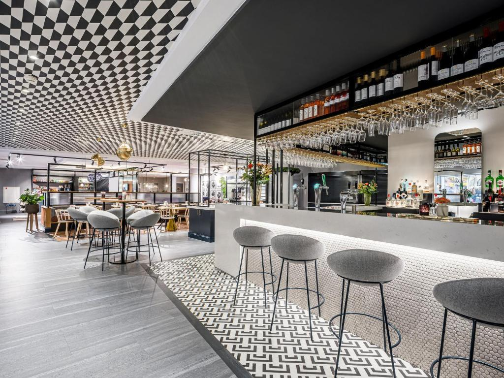 A restaurant or other place to eat at Novotel Den Haag City Centre '' Reopend June 2020, fully renovated''