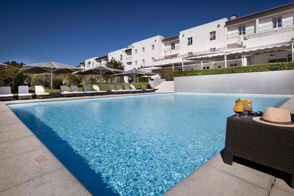 The swimming pool at or near M'AR De AR Muralhas