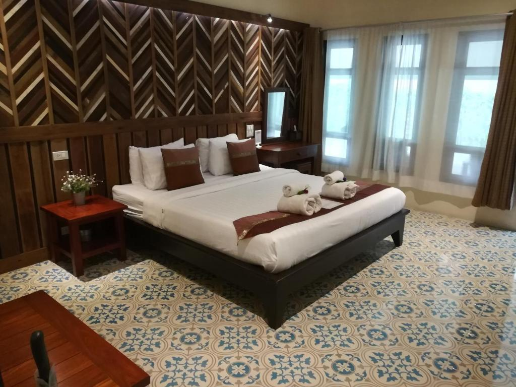 A bed or beds in a room at Good Times Resort