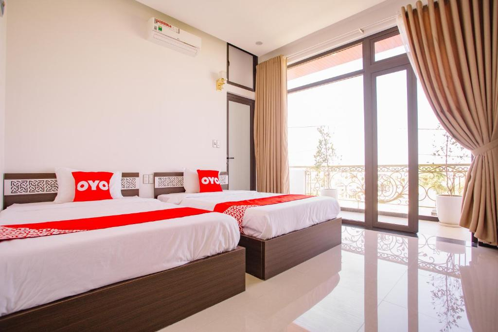 A bed or beds in a room at OYO 849 Thanh Phuong Hotel