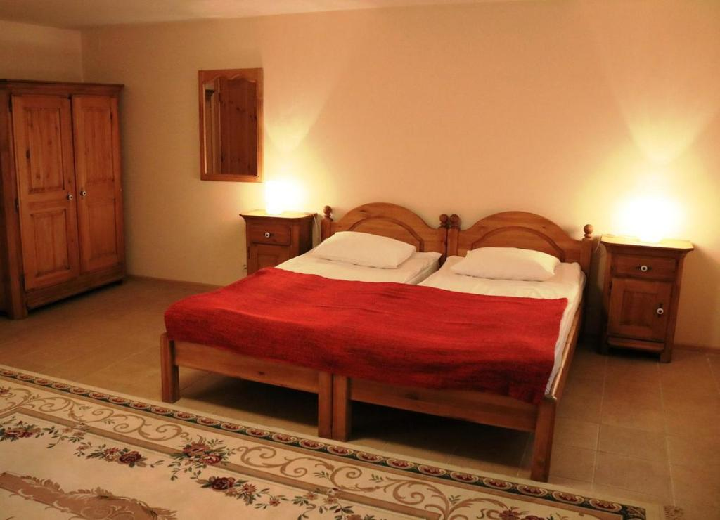A bed or beds in a room at Lesotel