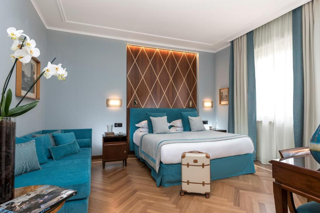 A bed or beds in a room at Bettoja Hotel Mediterraneo