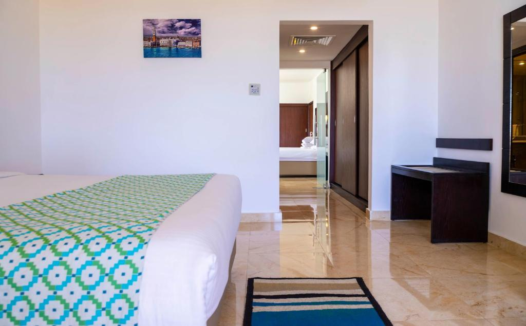 A bed or beds in a room at Elphistone Resort Marsa Alam for families and couples only