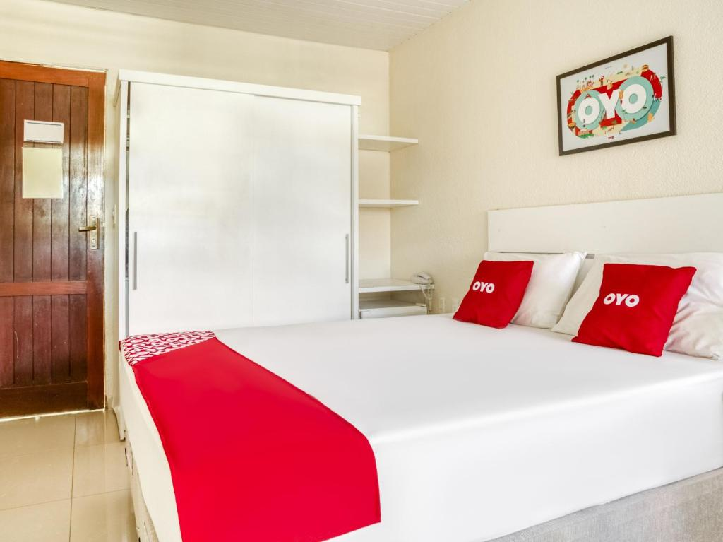 A bed or beds in a room at OYO Hotel Stella Maris