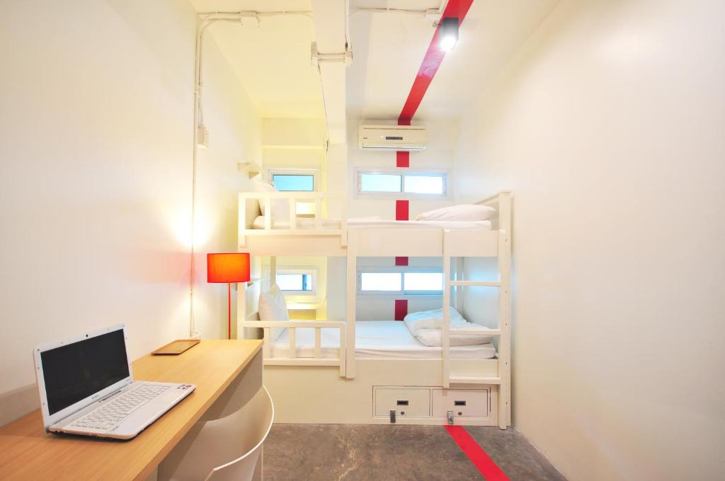 A bunk bed or bunk beds in a room at HQ Hostel Silom