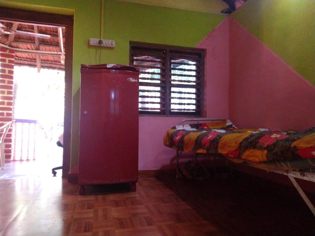 A bed or beds in a room at Kotadi Natural Holiday homes