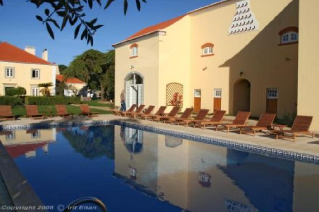 The swimming pool at or near Quinta Do Scoto