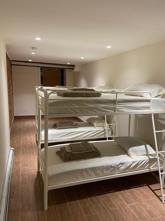A bunk bed or bunk beds in a room at Shared Room In Upper East Manhattan