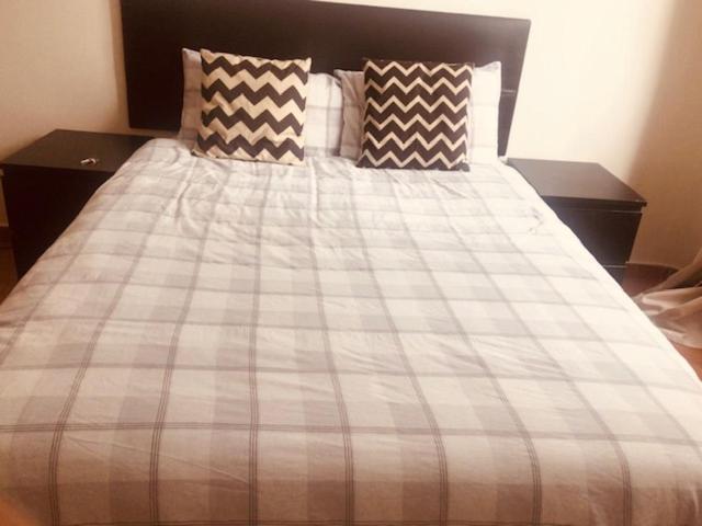 A bed or beds in a room at Cómoda Habitación Gran Vía