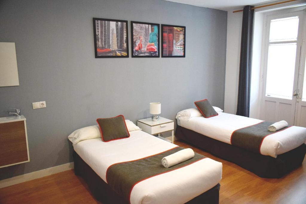 Cama o camas de una habitación en Hostal Tormes