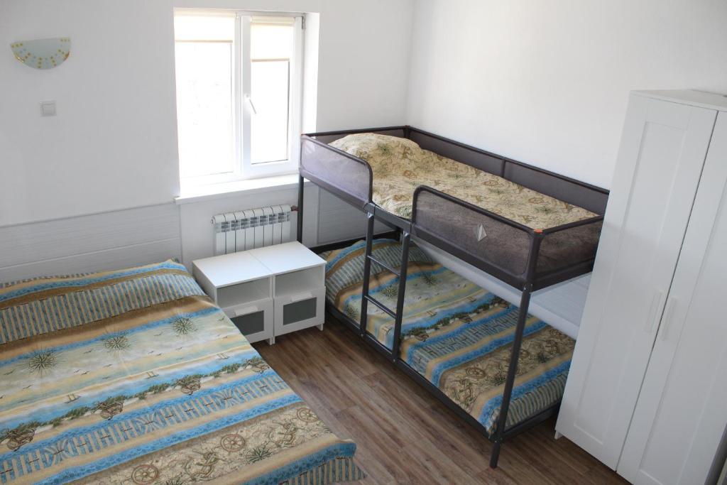 Кровать или кровати в номере Дом на Лесной