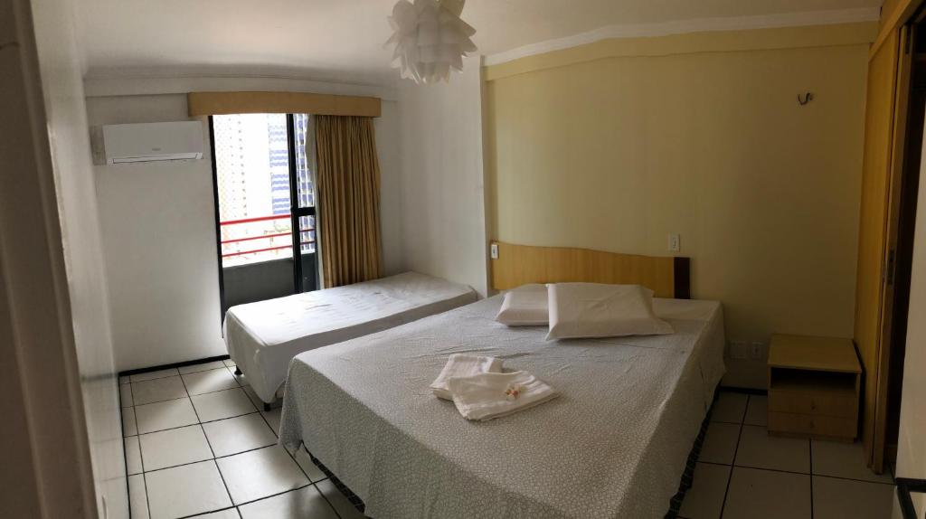 A bed or beds in a room at Porto de Iracema Flats