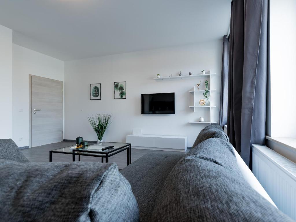 Ein Sitzbereich in der Unterkunft Moderne 3-Zimmerwohnung mitten im Stadtzentrum