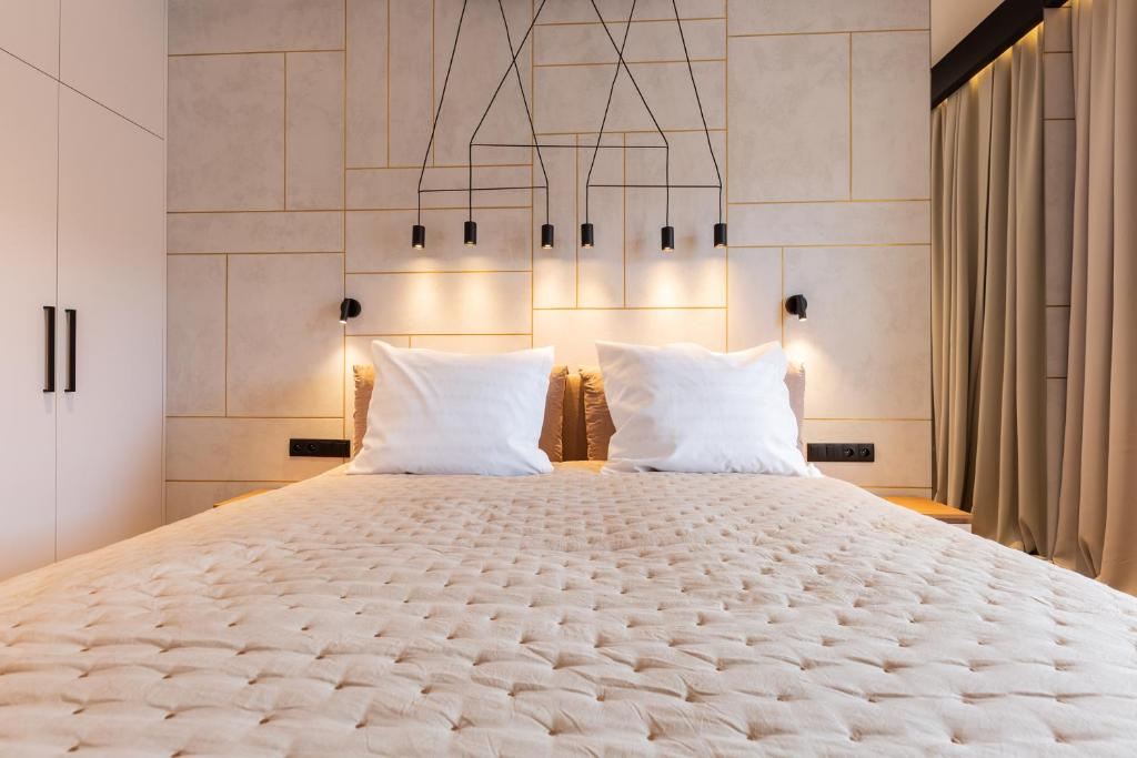 A bed or beds in a room at Baltic Apartments Seaside Towers
