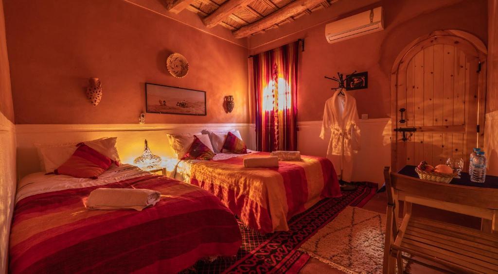 Un ou plusieurs lits dans un hébergement de l'établissement Auberge Atlas Dades