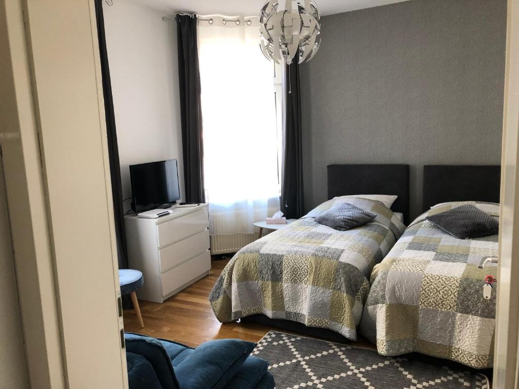 A bed or beds in a room at Ana Apartment