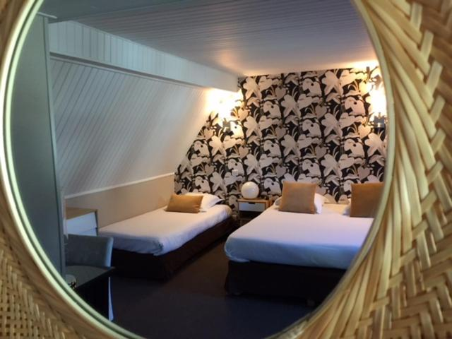 A bed or beds in a room at Hotel Ajoncs d'Or