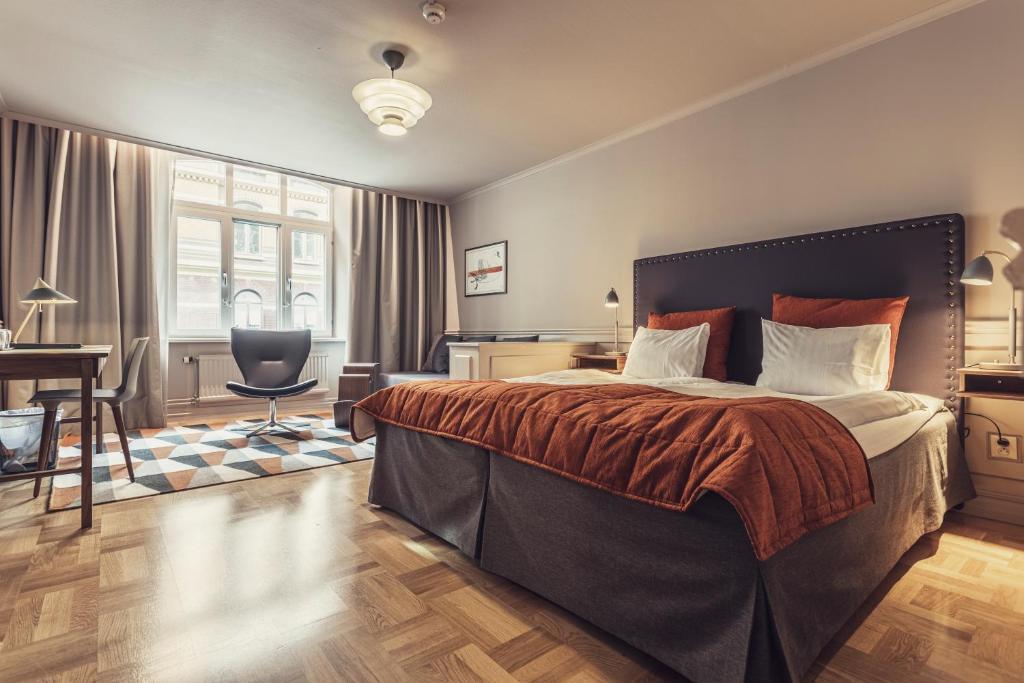 Lova arba lovos apgyvendinimo įstaigoje Hotel Poseidon