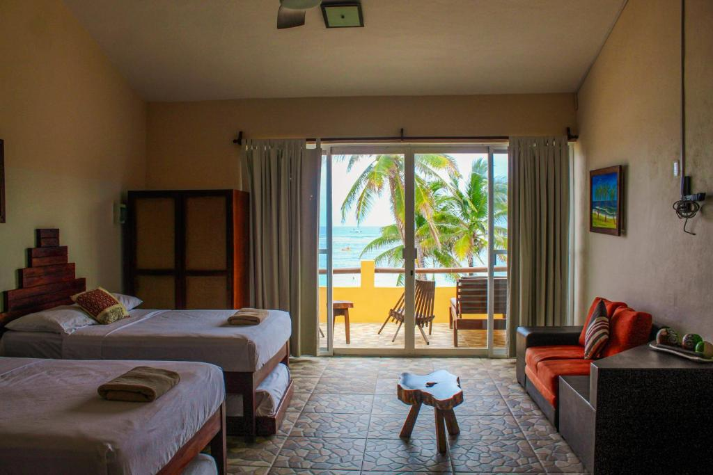 A bed or beds in a room at Maha Sand Suites Hotel & Hostel