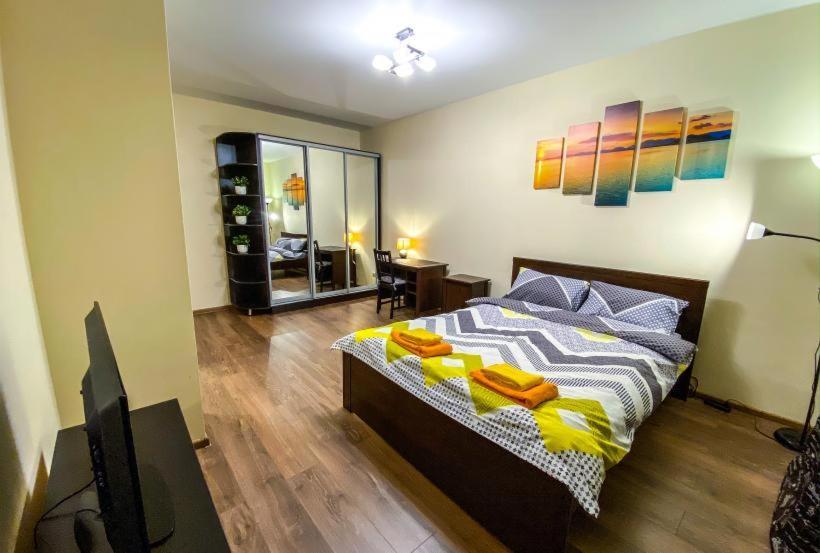 Кровать или кровати в номере 1-комнатная квартира с капитальным ремонтом «под евро».