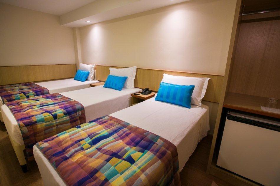Cama ou camas em um quarto em Lapa Ville Hotel