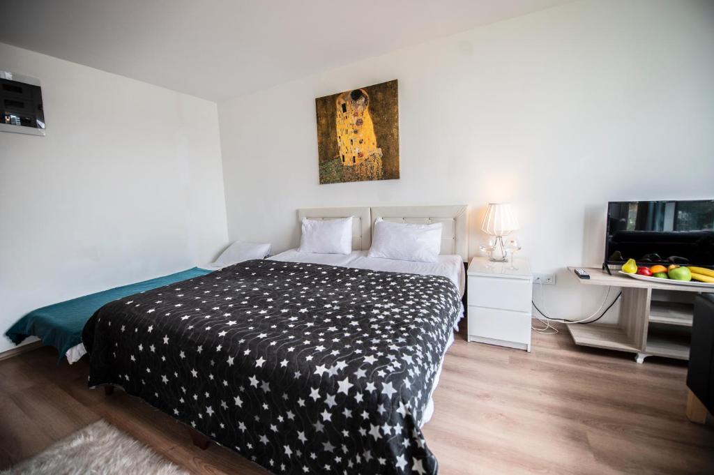 Кровать или кровати в номере We Home Fulya
